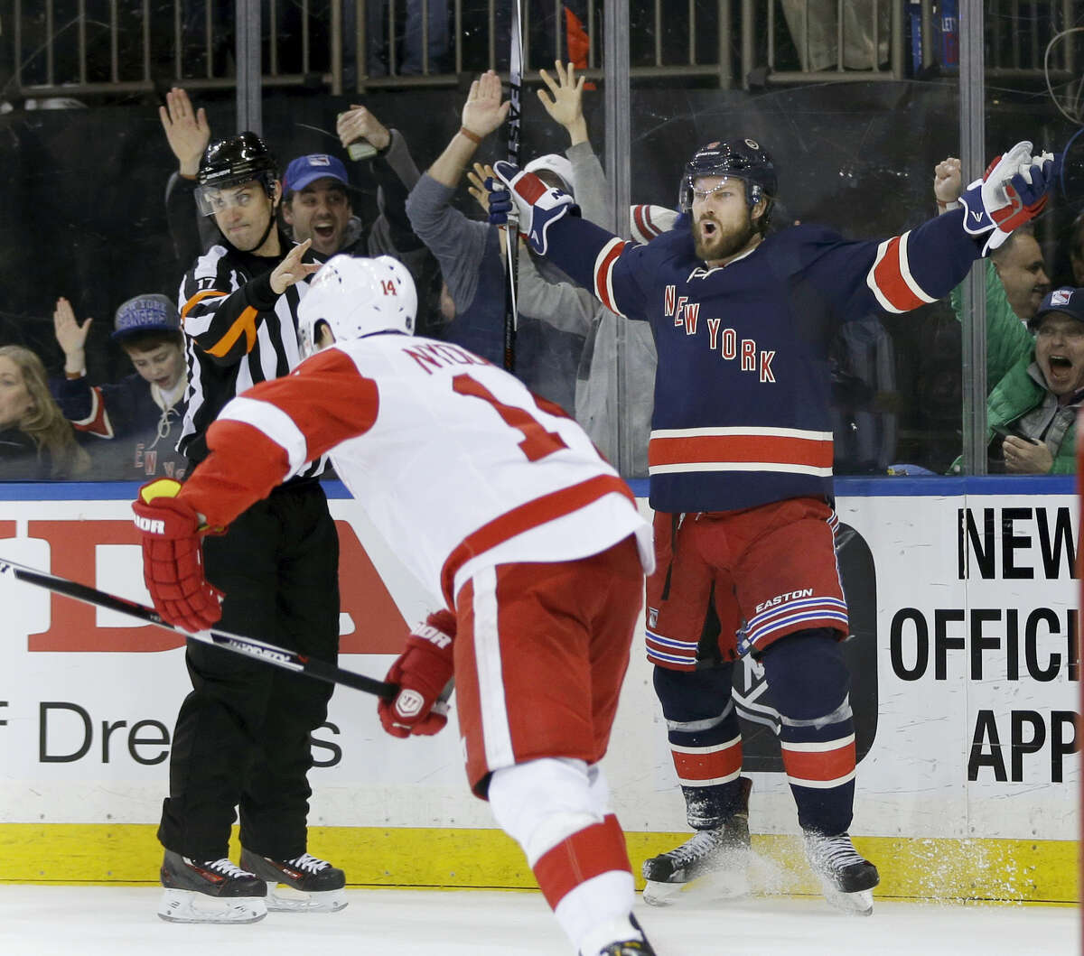 New York Rangers' Kevin Klein, right, reacts after scoring the winning goal during the overtime period of the NHL hockey game against the Detroit Red Wings, Sunday, Feb. 21, 2016, in New York. The Rangers defeated the Red Wings in overtime 1-0. (AP Photo/Seth Wenig)