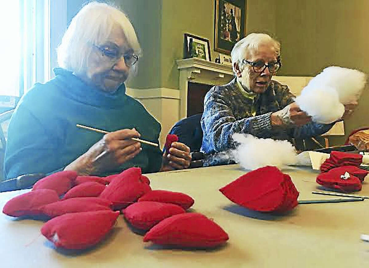 Agnes DiStefano, left, and Lois Dragone, right, stuff hearts during their weekly Thursday meeting with the House of Talents. Each year, the Church of Holy Trinity group makes ABC charts to help children learn their alphabet.