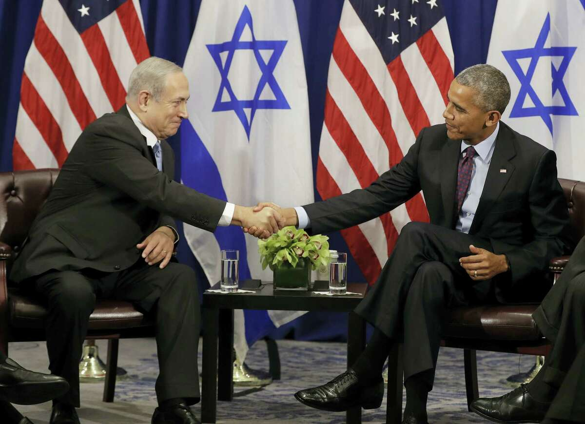 President Barack Obama shakes hands with Israeli Prime Minister Benjamin Netanyahu during a bilateral meeting at the Lotte New York Palace Hotel in New York, Wednesday, Sept. 21, 2016.