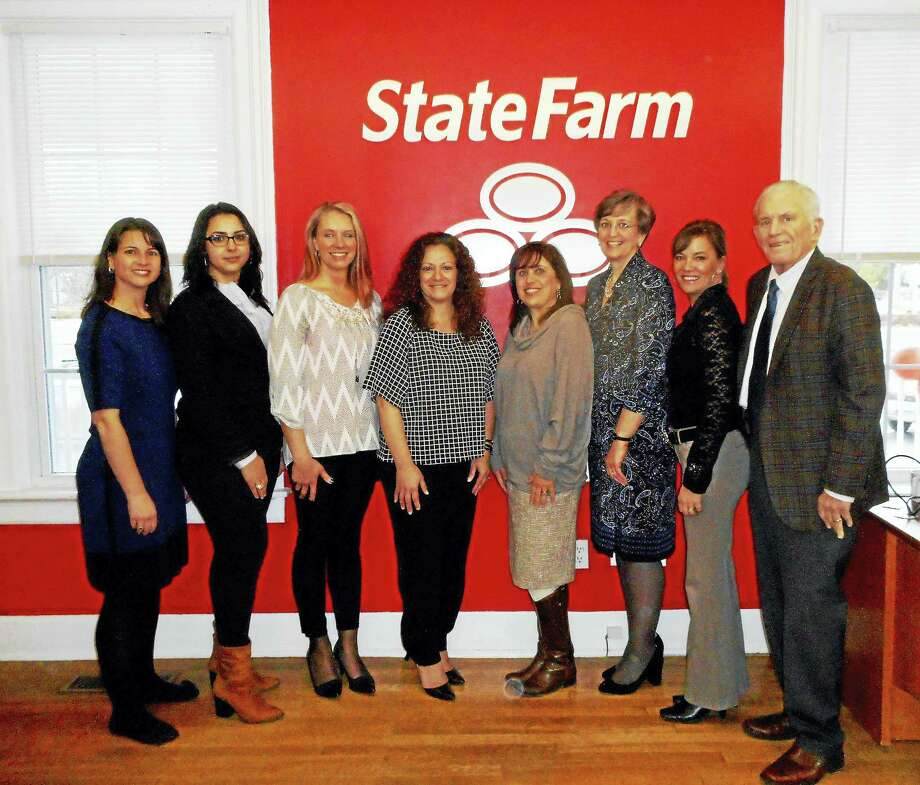 State Farm Insurance in Portland held its grand opening Feb. 4. From left are: state Rep. Christie Carpino, State Farm personal account representatives Kattie Viveiros and Sharon Leland, and owner/agent Mimma Burke; Town Planner Deanna Rhodes, Economic Development Consultant Mary Dickerson, Chamber Vice President Johanna Bond, and Chamber President Larry McHugh. Photo: Courtesy Photo