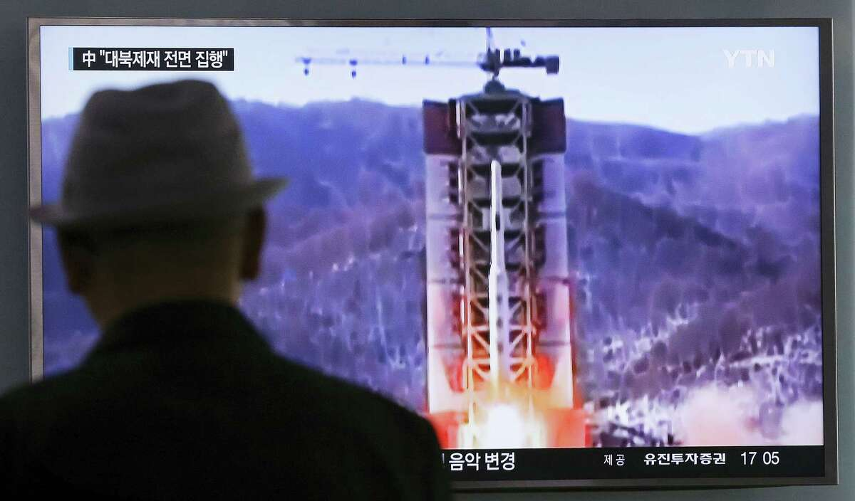 A man watches a TV news program showing a file footage of North Korea's rocket launch at Seoul Railway Station in Seoul, South Korea on April 28, 2016. A suspected powerful intermediate-range North Korean missile crashed moments after liftoff Thursday,