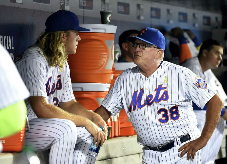 Mets pitching coach Dan Warthen, right, talks with Noah Syndergaard in the dugout in the fourth inning oN Friday. Photo: Kathy Kmonicek — The Associated Press  / FR170189 AP