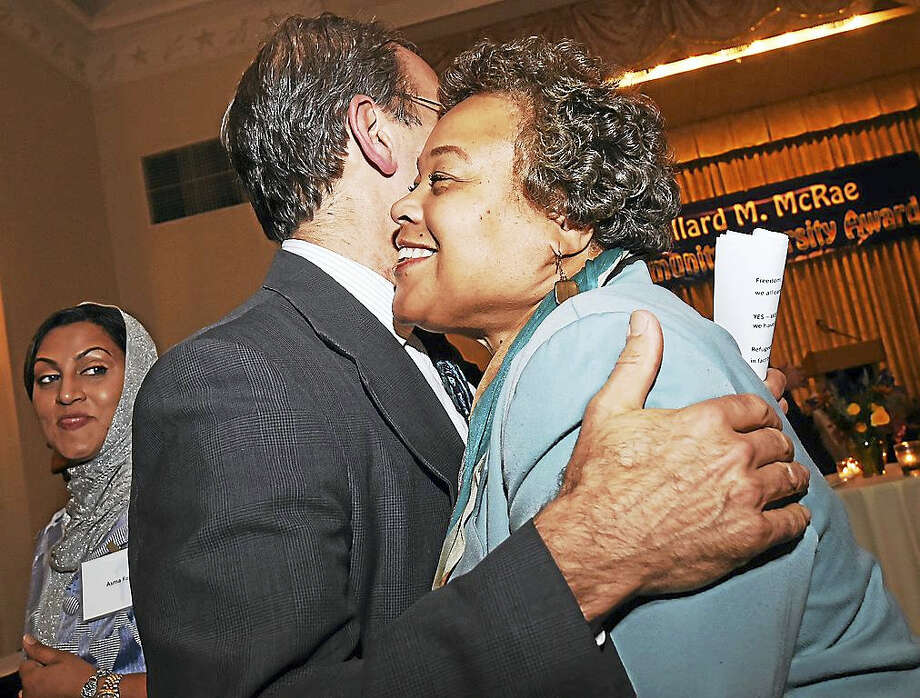 Faith M. Jackson, director of human relations for the city of Middletown, congratulates Chris George, executive director of Integrated Immigrant and Refugee Services, the recipient of the 2016 Willard M. McRae Community Diversity Award; at the New Haven Lawn Club on Nov. 9. Photo: File Photo  / New Haven RegisterThe Middletown Press