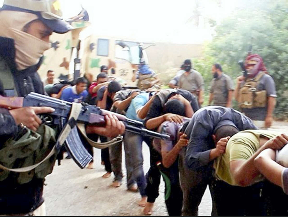 This image posted online by Islamic State militants on June 14, 2014 shows Iraqi cadets captured by IS moments before they were killed in Tikrit, Iraq. Their bodies are believed to be in one of the many mass graves left behind by Islamic State extremists. An analysis by The Associated Press has found 72 such graves in Iraq and Syria, and many more are expected to be discovered as the group loses territory.