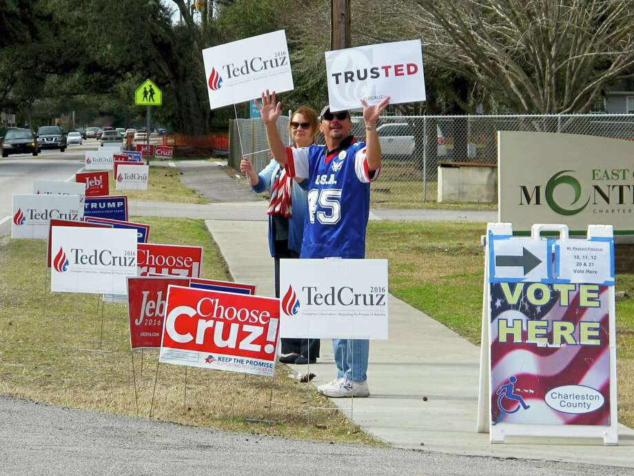 Supporters of Texas Sen. Ted Cruz hold campaign signs outside a polling place in Mount Pleasant, S.C., during the GOP presidential primary in South Carolina on Feb. 20, 2016. Photo: AP Photo/Bruce Smith  / AP