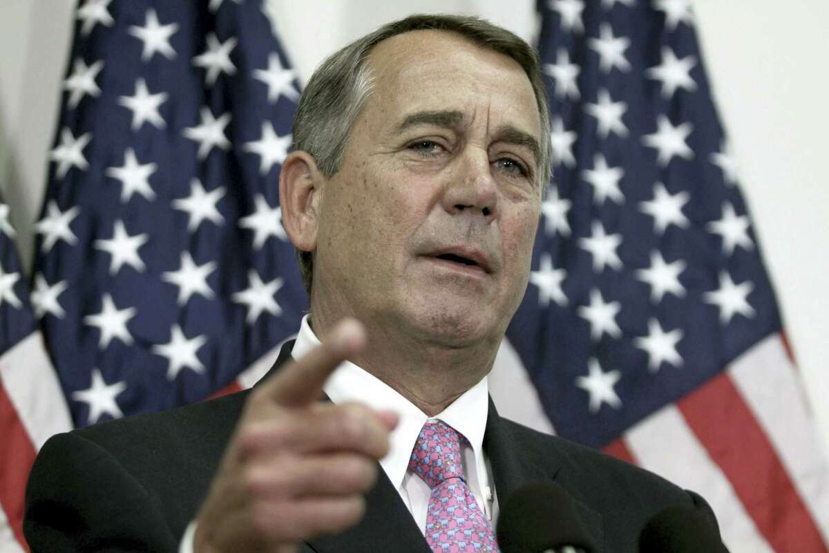 """In this Oct. 27, 2015 file photo, then-House Speaker John Boehner of Ohio talks with reporters on Capitol Hill in Washington. Boehner unloaded on Republican presidential candidate Ted Cruz during a talk to college students, calling the Texas senator """"Lucifer in the flesh."""" Speaking at a town hall-style event at Stanford University Wednesday, April 27, 2016, Boehner called front-runner Donald Trump his """"texting buddy,"""" but offered a more graphic response when asked about Cruz."""