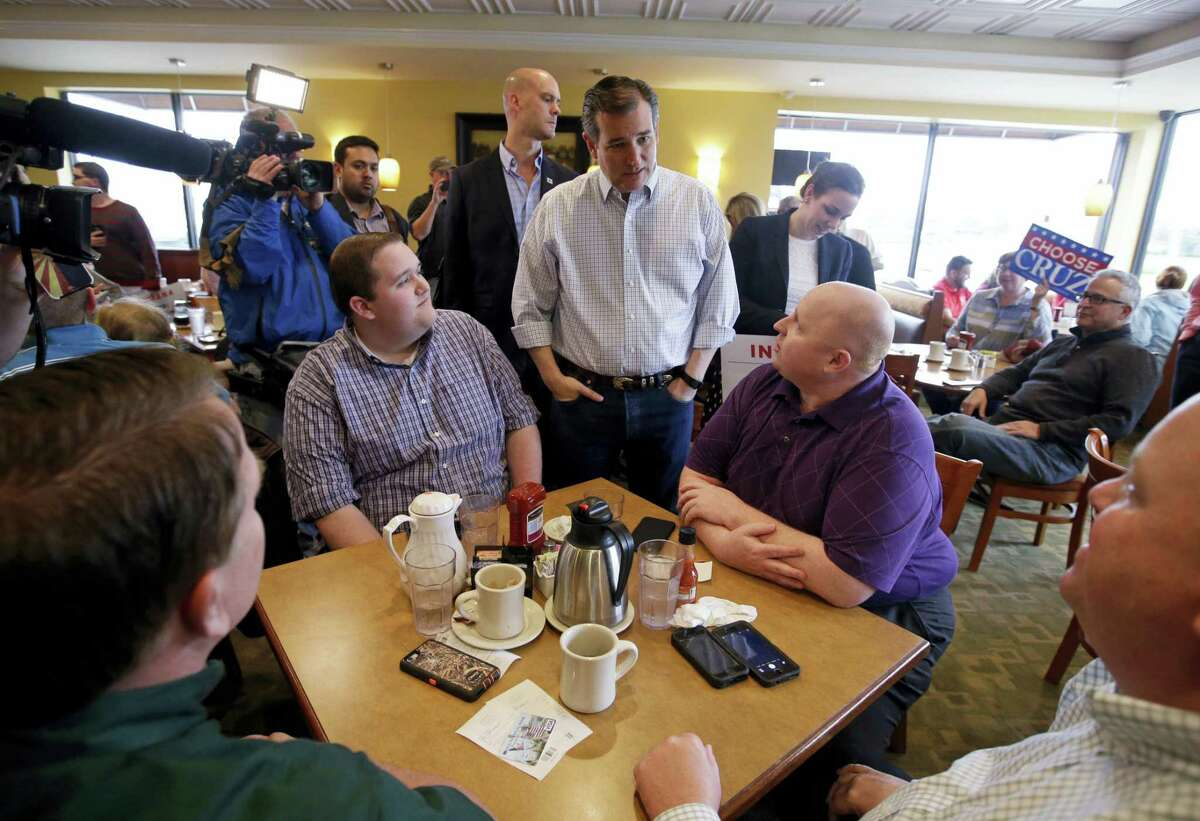 Republican presidential candidate, Sen. Ted Cruz, R-Texas, speaks with patrons during a campaign stop at Sister's Place Restaurant Wednesday, April 27, 2016, in Indianapolis.