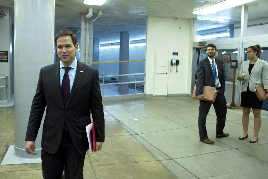 Sen. Marco Rubio, R-Florida, walks through the Capitol in Washington on Tuesday. Photo: ASSOCIATED PRESS  / Cliff Owen