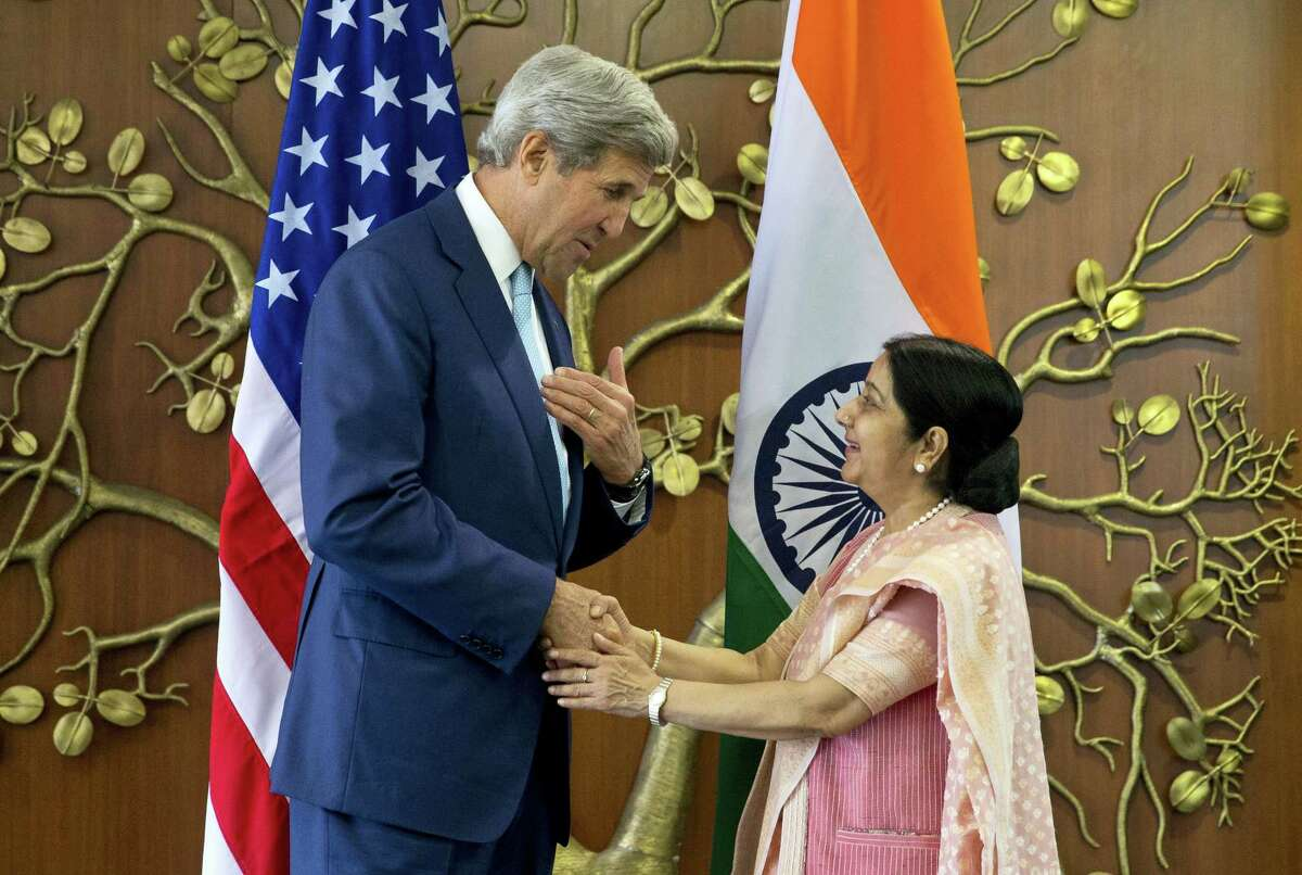Indian Foreign Minister Sushma Swaraj, right, greets U.S. Secretary of State John Kerry in New Delhi, India on Aug. 30, 2016. Kerry is on a three-day visit to India.
