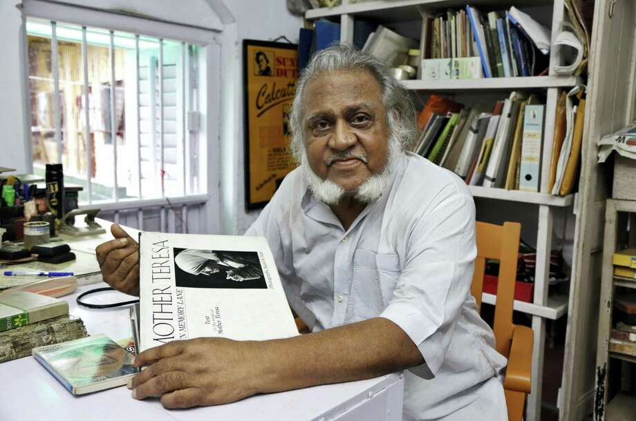 "In this Aug. 29, 2016, photo, freelance photographer Sunil K. Dutt displays his book on Mother Teresa in Kolkata, India. Dutt began covering Mother Teresa's work in Kolkata in 1965 and has one of the largest collections of photographs of the nun. ""From the day I first met her Mother always appeared to me a living saint in action,"" the 80-year-old said. ""My association with Mother Teresa has impacted my life in a very big way. Whenever I think of her I feel a profound peace in the very core of my heart."" Photo: AP Photo/Bikas Das   / Copyright 2016 The Associated Press. All rights reserved."