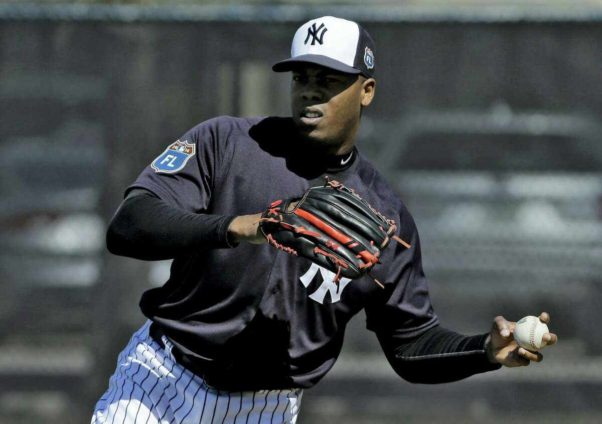 Yankees pitcher Aroldis Chapman throws a ball during a workout Friday in Tampa, Fla.