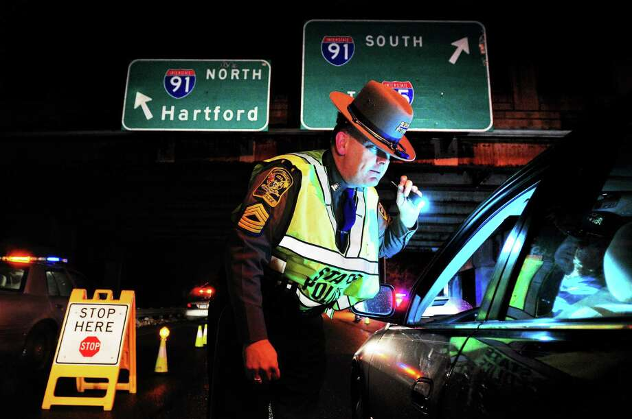 A Connecticut state trooper checks drivers for alcohol consumption at a sobriety check point. Photo: File Photo