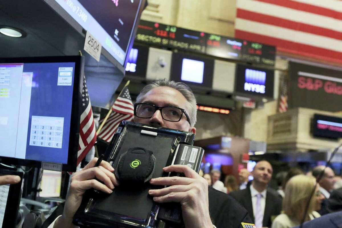 Trader Eric Schumacher works on the floor of the New York Stock Exchange Thursday.