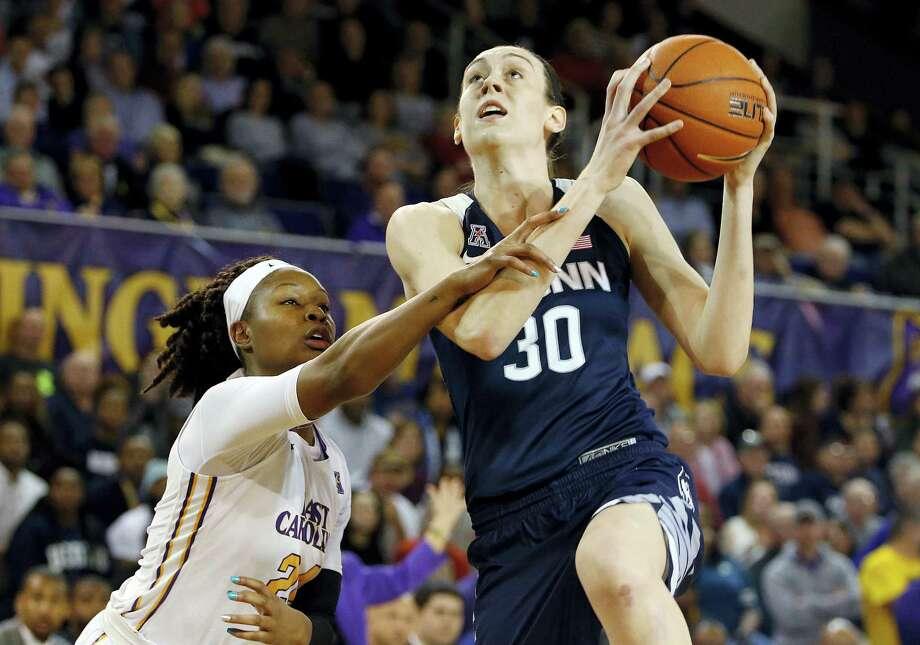 UConn's Breanna Stewart (30) drives the ball past East Carolina I'Tiana Taylor during Saturday's game. Photo: Karl B. DeBlaker — The Associated Press  / FR7226 AP