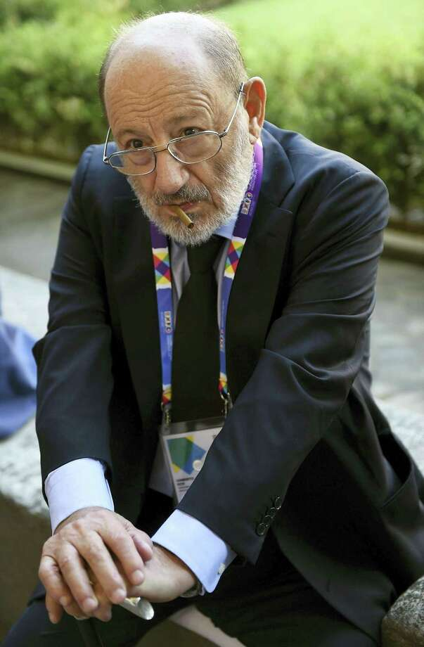 "In this Aug. 1, 2015 file photo, Italian writer Umberto Eco waits to visit Italian artist Leonardo Da Vinci's painting ""The last Supper"", Milan, Italy.  Eco, best known for the international best-seller ""The Name of the Rose,"" died Friday, Feb. 19, 2016. He was 84. Photo: Daniel Dal Zennaro/ANSA Via AP, File   / ANSA"