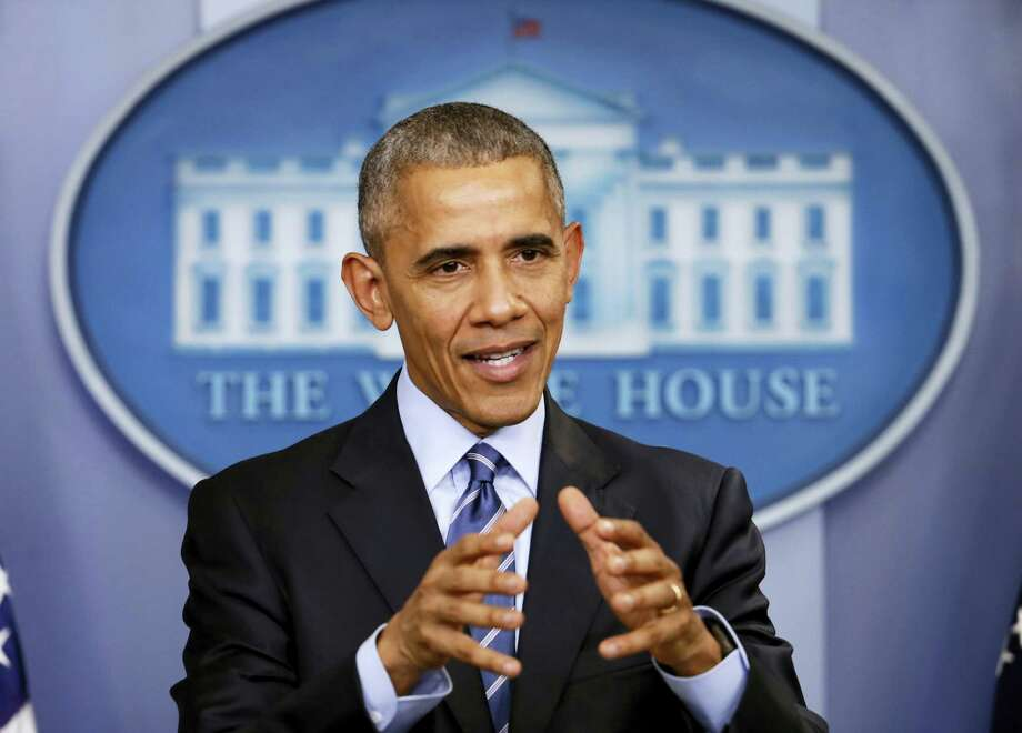 In this photo taken Dec. 16, 2016, President Barack Obama speaks during a news conference in the briefing room of the White House in Washington. President Barack Obama has imposed sanctions on Russian officials and intelligence services in retaliation for Russia's interference in the U.S. presidential election by hacking American political sites and email accounts. (AP Photo/Pablo Martinez Monsivais) Photo: AP / Copyright 2016 The Associated Press. All rights reserved.