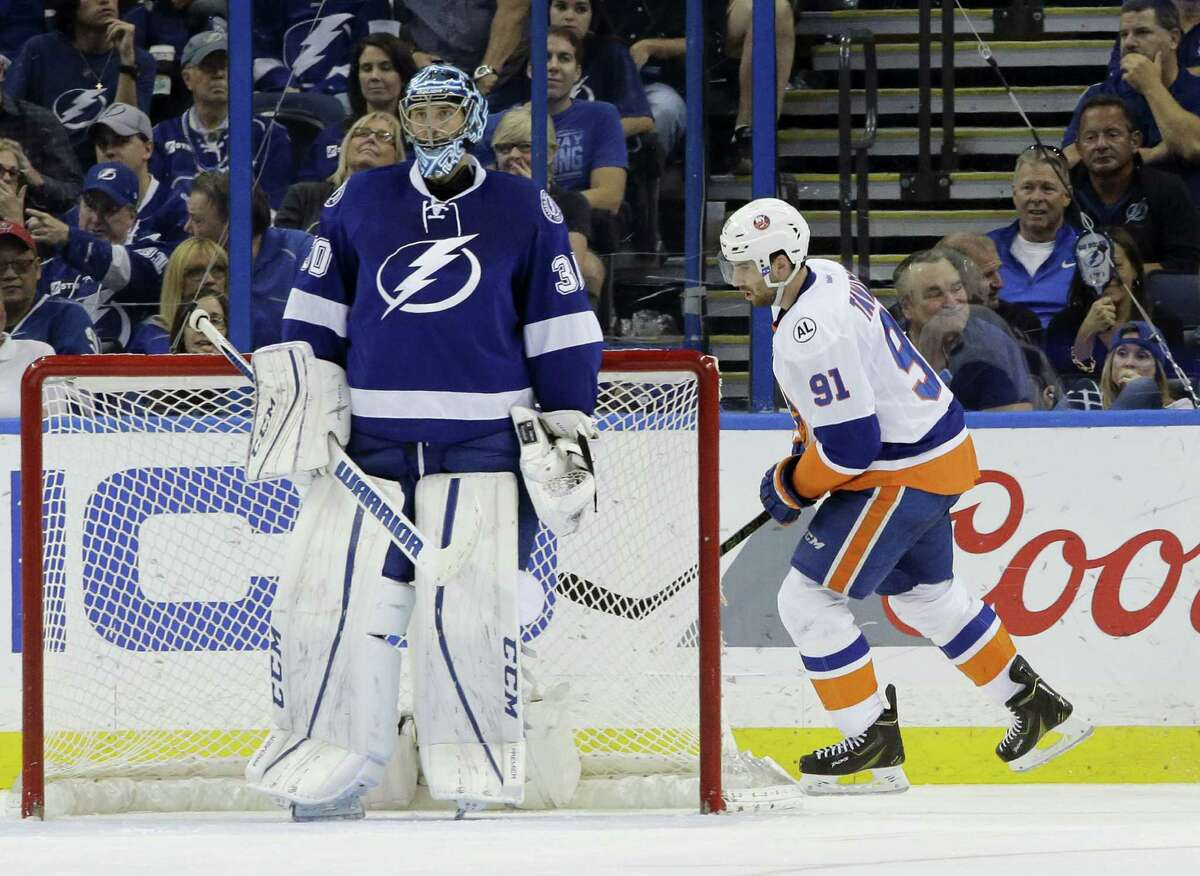 New York Islanders' John Tavares (91) skates behind Tampa Bay Lightning goalie Ben Bishop (30) after Tavares scores the fourth New York Islanders goal during the second period of Game 1 of the NHL hockey Stanley Cup Eastern Conference semifinals Wednesday in Tampa, Florida.