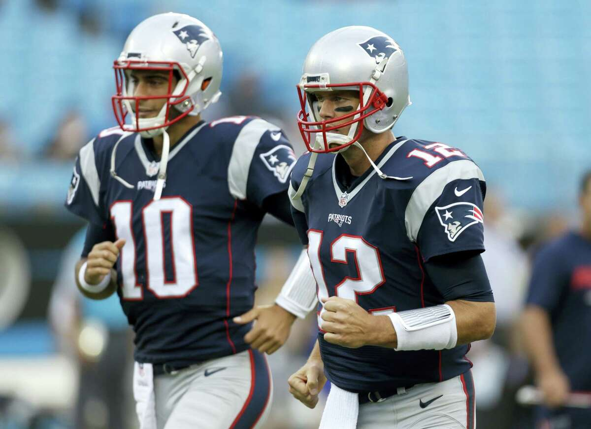 New England Patriots quarterbacks Tom Brady (12) and Jimmy Garoppolo.