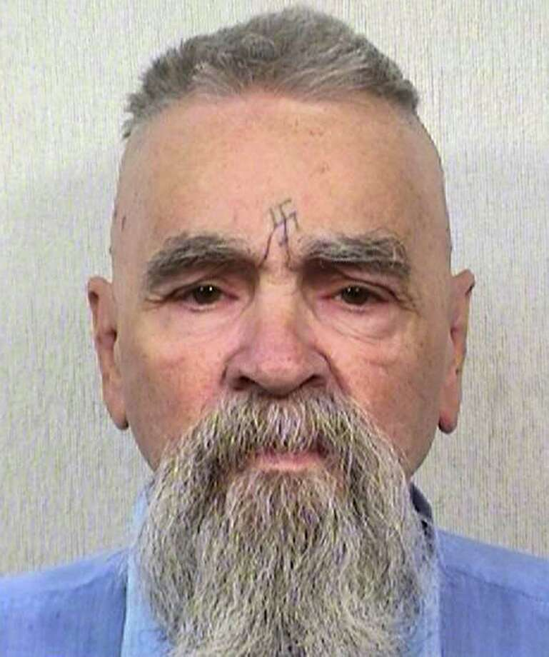 "This Oct. 8, 2014, photo provided by the California Department of Corrections shows 80-year-old serial killer Charles Manson. A marriage license has been issued for Manson to wed 26-year-old Afton Elaine Burton, who left her Midwestern home nine years ago and moved to Corcoran, California to be near him. Burton, who goes by the name ""Star,"" told the AP that she and Manson will be married next month. Photo: AP Photos/California Department Of Corrections   / CALIFORNIA DEPARTMENT OF CORRECTIONS."