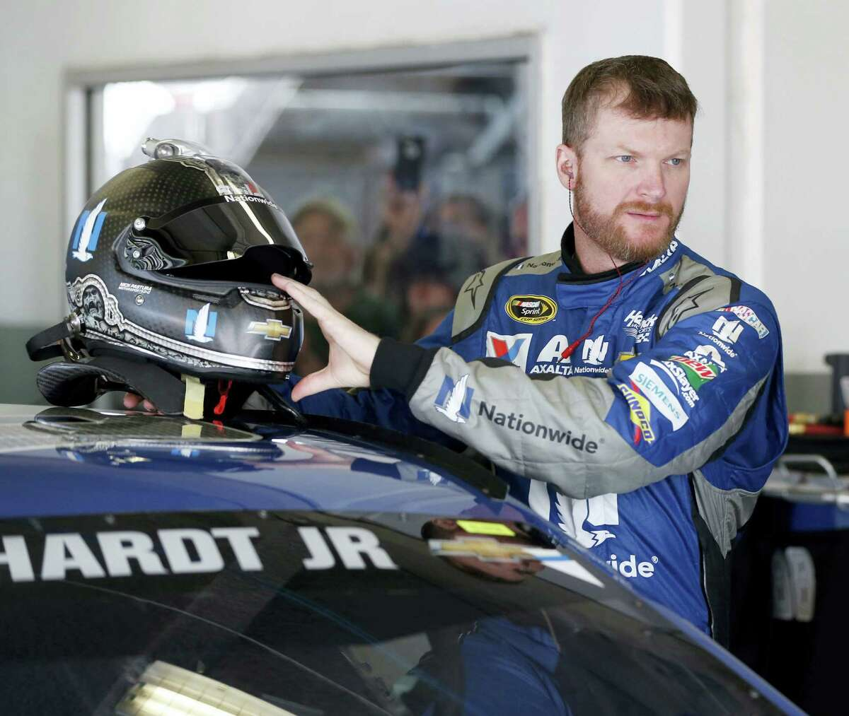 Dale Earnhardt Jr prepares to climb into his car during practice on Friday for Sunday's Daytona 500.