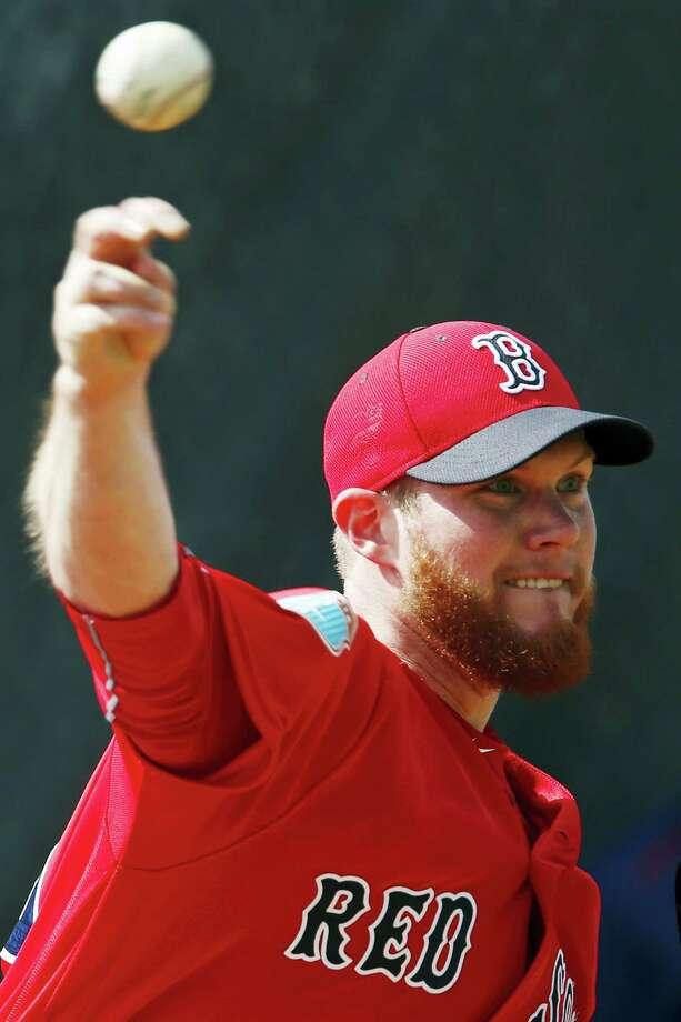 Red Sox relief pitcher Craig Kimbrel throws during spring training on Friday. Photo: Corey Perrine — Naples Daily News Via AP  / Naples Daily News