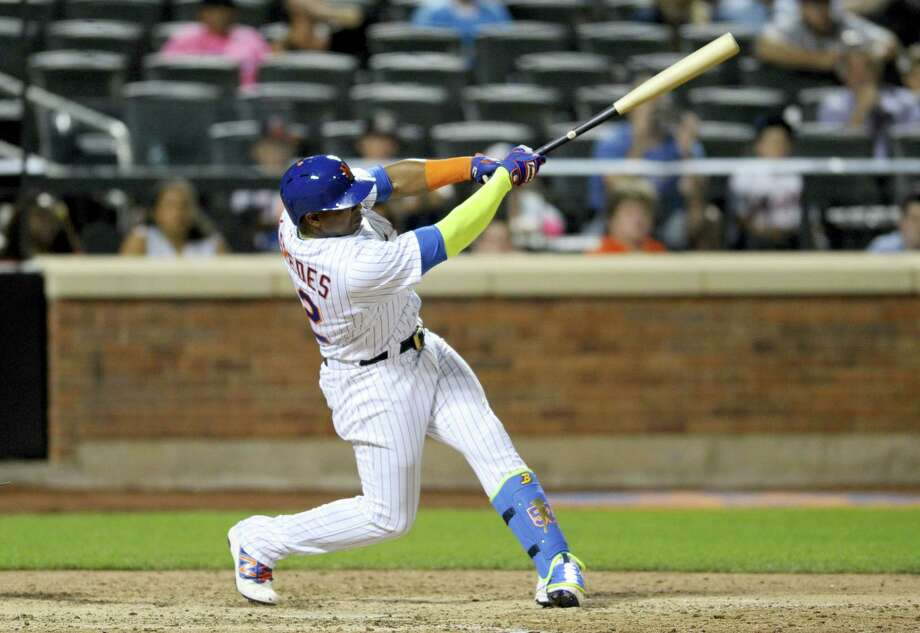 Yoenis Cespedes hit a walk-off home run in the 10th inning on Monday. Photo: Bill Kostroun — The Associated Press  / FR51951 AP