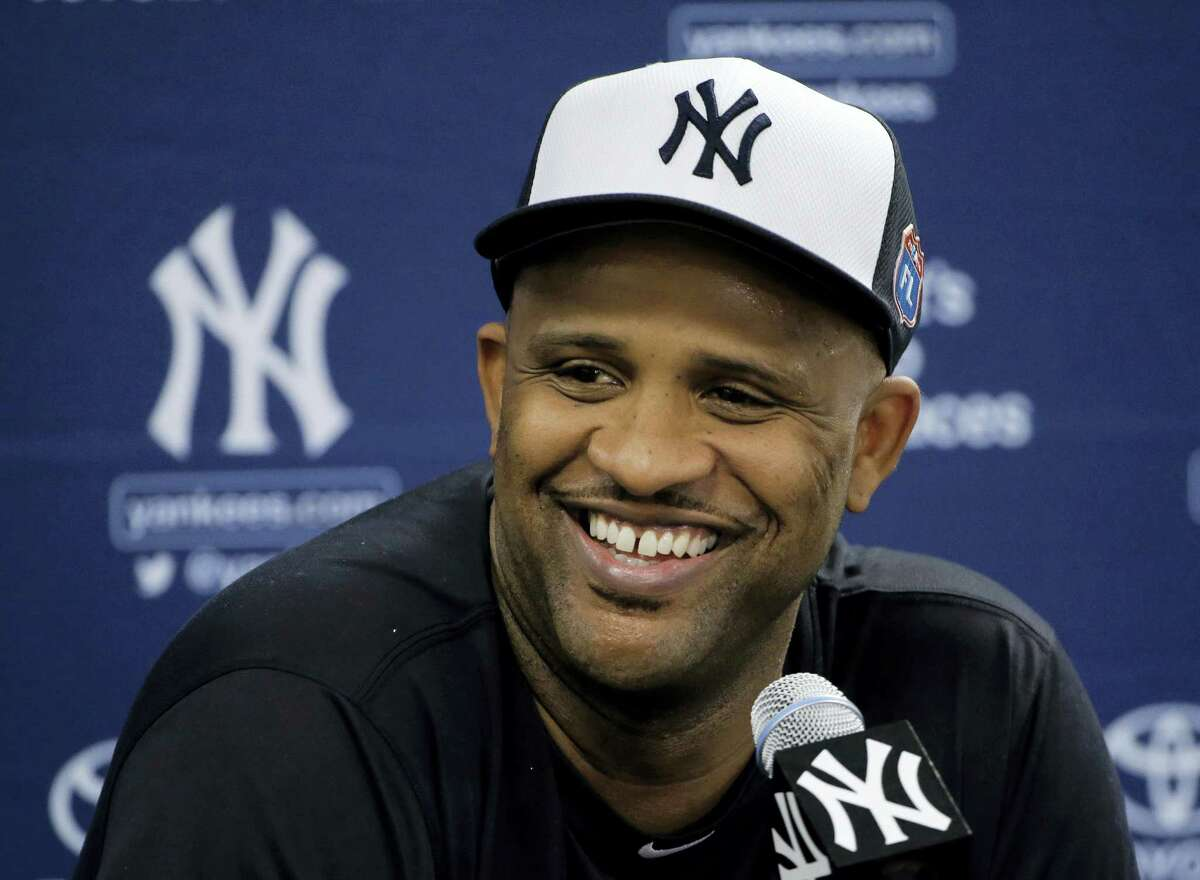 Yankees pitcher CC Sabathia smiles during a news conference Friday in Tampa, Fla.