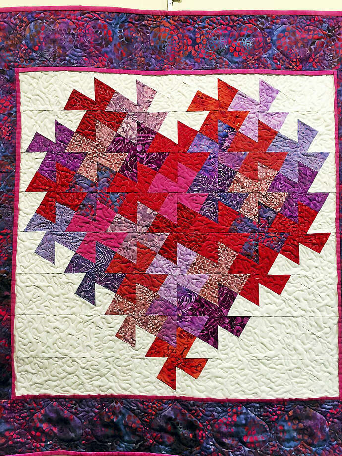 """The Acton Public Library, 60 Old Boston Post Road Old Saybrook, announces February Guest Artist Michele Holt of Old Saybrook. Ms.Holt has been quilting since she was given a basic sewing machine in 1997, and the hobby """"quickly turned into a passion."""" She creates custom quilts, t-shirt quilts, and memory quilts which can be seen at her website, myquiltingbeehive.com. This exhibit will be on display in the library through February 29. For further information, please call 860-395-3184 Photo: Journal Register Co."""