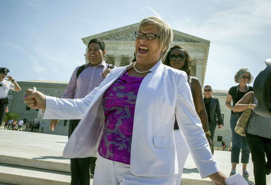 Amy Hagstrom Miller, founder of Whole Woman's Health, a Texas women's health clinic that provides abortions, rejoices as she leaves the Supreme Court in Washington Monday as the justices struck down the Texas law known as HB2. Photo: THE ASSOCIATED PRESS  / AP