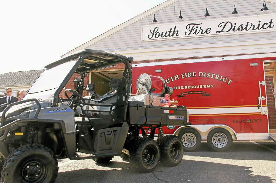 A new all-terrain vehicle was dedicated on Wednesday at South Fire District in Middletown. The vehicle offers improved ability to fight fires and perform rescues in the wide, wooded terrain that comprises the station's coverage area. Photo: Kathleen Schassler — The Middletown Press  / Kathleen Schassler All Rights