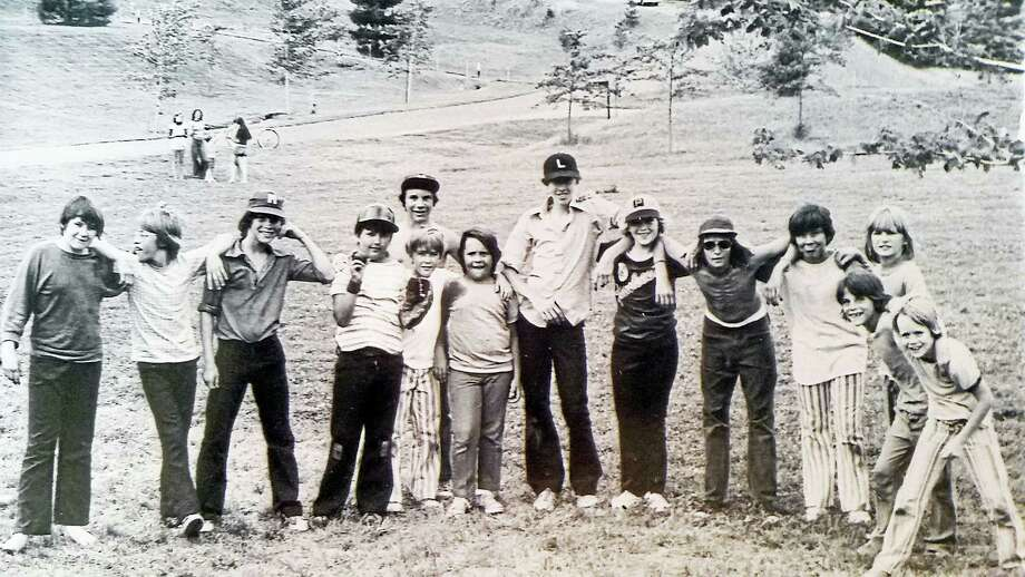 """The """"boys of summer"""" shown at the former Xerox lot on Long Hill Road in Middletown are, from left, John Vincent, Dennis DeStefano, Gino Scalise, David Duke Snyder, Todd Bickmore in the striped pants (the young men behind and to the right of Bickmore are unidentified), Joe Worlansky, (the boy in the white cap is unidentified) Chuck Ramos, Glen Manemite, Mark Scalis, a Gawlak child and Michael Batchelder. Photo: Courtesy Wendy P. Manemeit"""