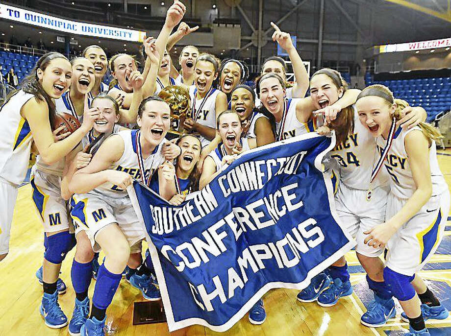 The 2015 Mercy Tigers celebrate after defeating the Hand Tigers, 57-52, in last year's SCC Girls Basketball Championship at TD Bank Sports Center at Quinnipiac University in Hamden. Photo: Catherine Avalone — GameTime CT / New Haven RegisterThe Middletown Press