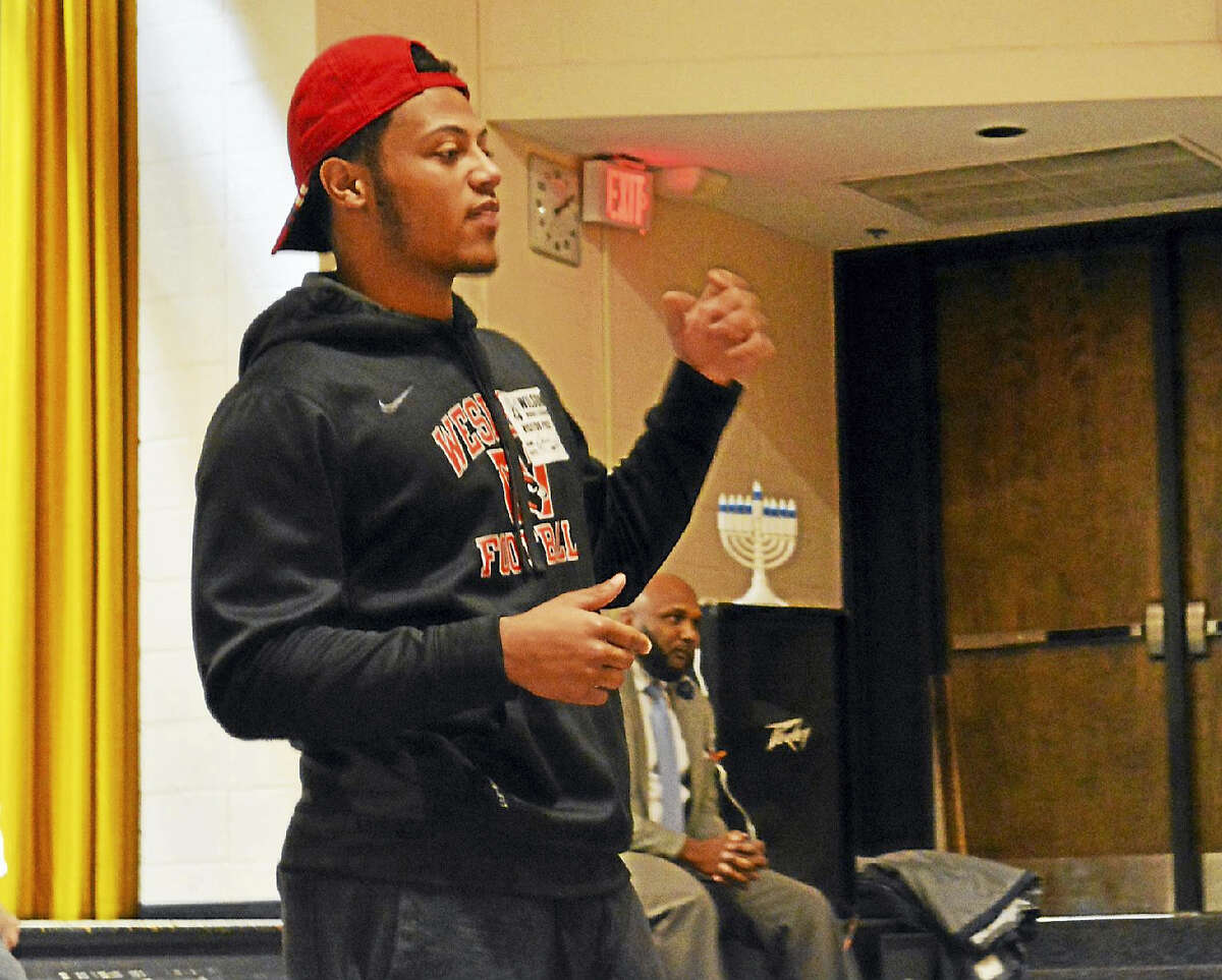 Wesleyan University running back/wide receiver and Middletown High School alumnus Dario Highsmith speaks to Woodrow Wilson Middle School students in mid-December as part of the X-Men program. He was joined by Wesleyan University Cardinals wide receiver, senior Devon Carrillo, who also graduated from the city high school. Other male role models encouraged the teens about focusing on their education.