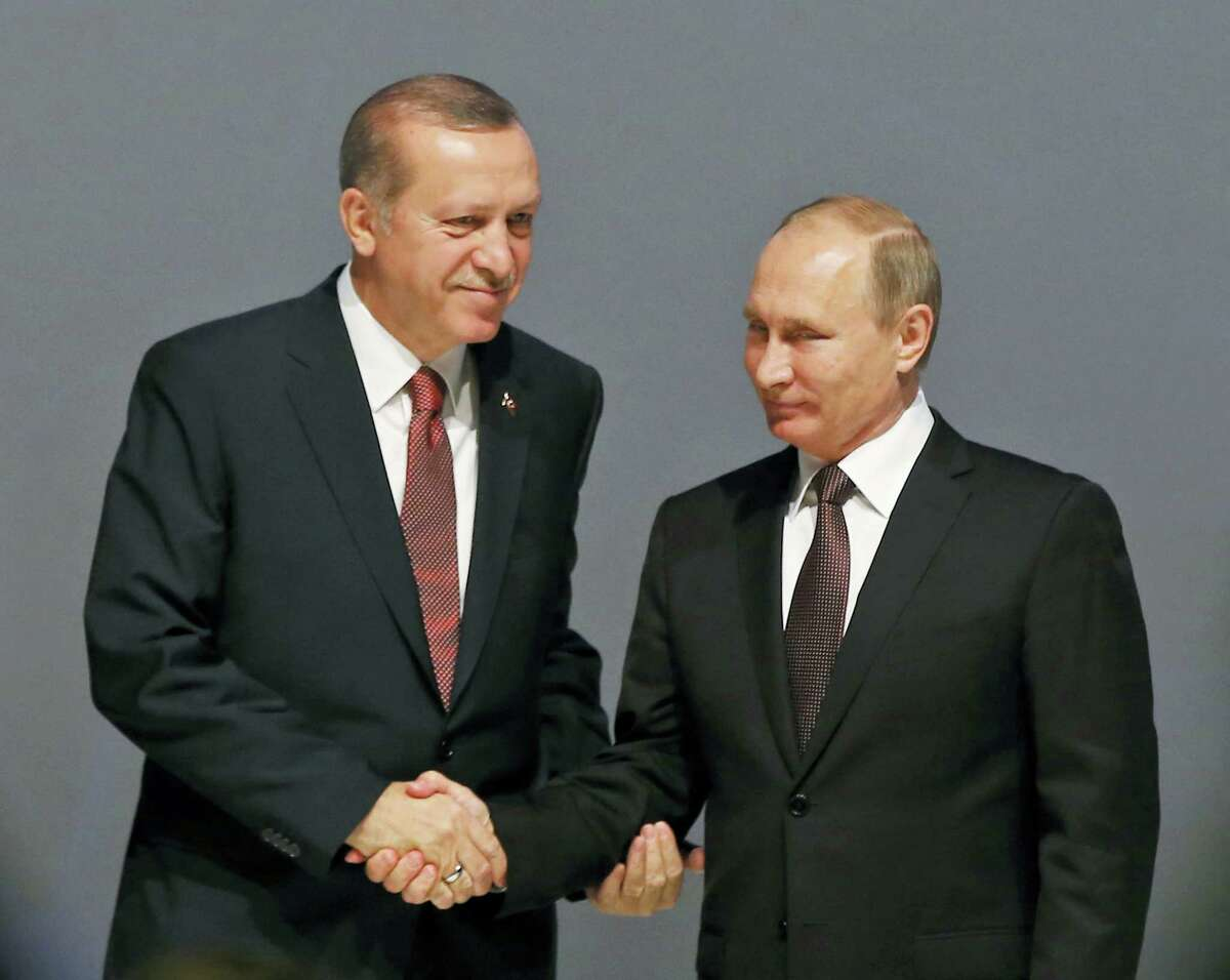 FILE — In this file photo, Turkey's President Recep Tayyip Erdogan, left and Russian President Vladimir Putin, shake hands following the group photo at the World Energy Congress, in Istanbul, Turkey. With his victory in Aleppo, Syrian President Bashar Assad appears to have survived a nearly six-year war to drive him from power, but he is now more dependent on outside powers than ever. His key allies Russia and Iran, along with Turkey, are best placed to determine Syria's endgame, which could more closely resemble a grand bargain among great powers than a political settlement among Syrians themselves.