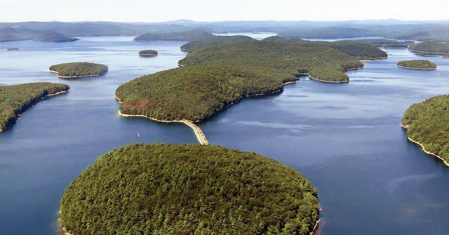 In this September 2013 aerial file photo provided by the Massachusetts Department of Conservation and Recreation, a dirt and stone road leads to Mount Zion Island, at rear, at the Quabbin Reservoir in Petersham, Mass. A plan by the state to start a colony of venomous timber rattlesnakes on the off-limits island in the state's largest drinking water supply came under fire, and became one of New England's odd stories in 2016. Photo: Mass. Dept. Of Conservation And Recreation Via AP  / Massachusetts Department of Conservation and Recreation