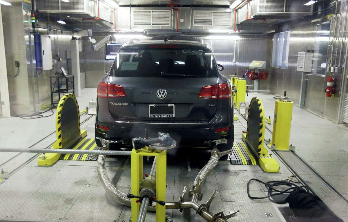 In this Oct. 13, 2015 photo, a Volkswagen Touareg diesel is tested in the Environmental Protection Agency's cold temperature test facility in Ann Arbor, Mich.