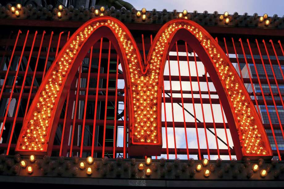 AP Photo/Gene J. Puskar This Jan. 10, 2016 photo shows the sign on the McDonald's on 42nd Street near Times Square in New York. Photo: AP / Copyright 2016 The Associated Press. All rights reserved. This material may not be published, broadcast, rewritten or redistributed without permission.