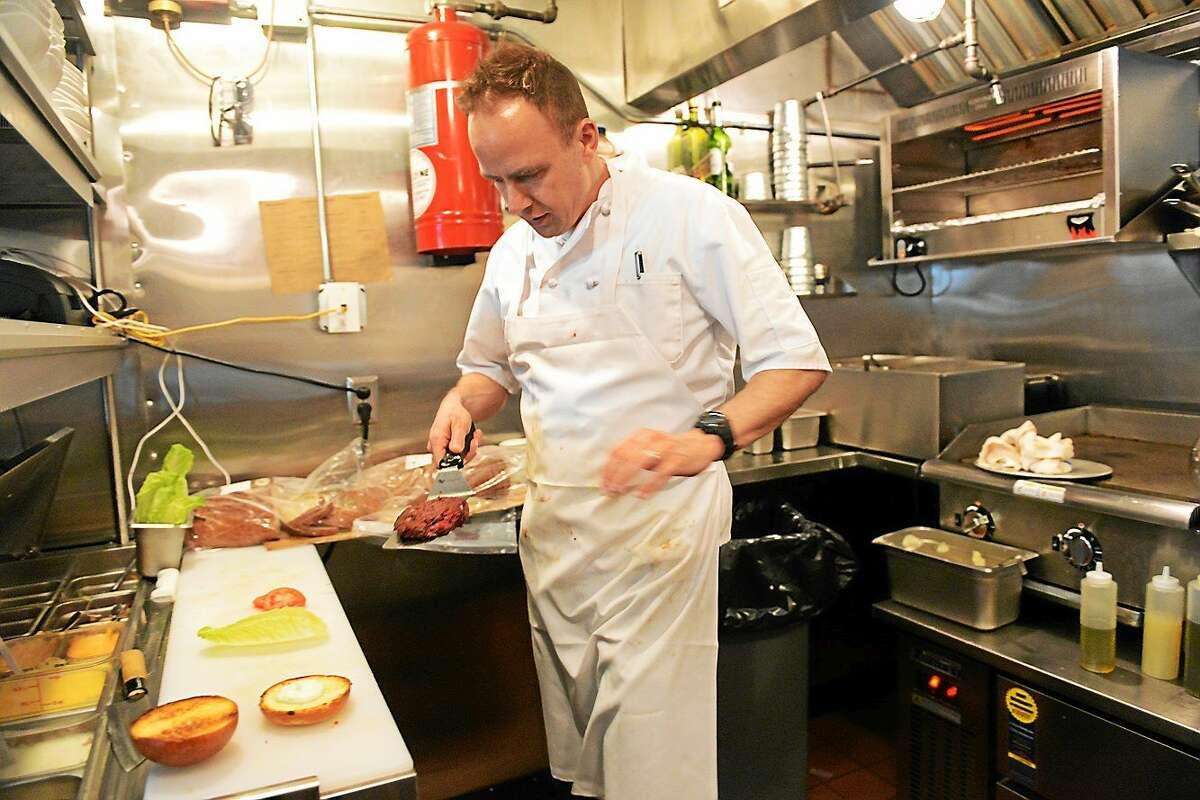A chef serves up a veggie burger.