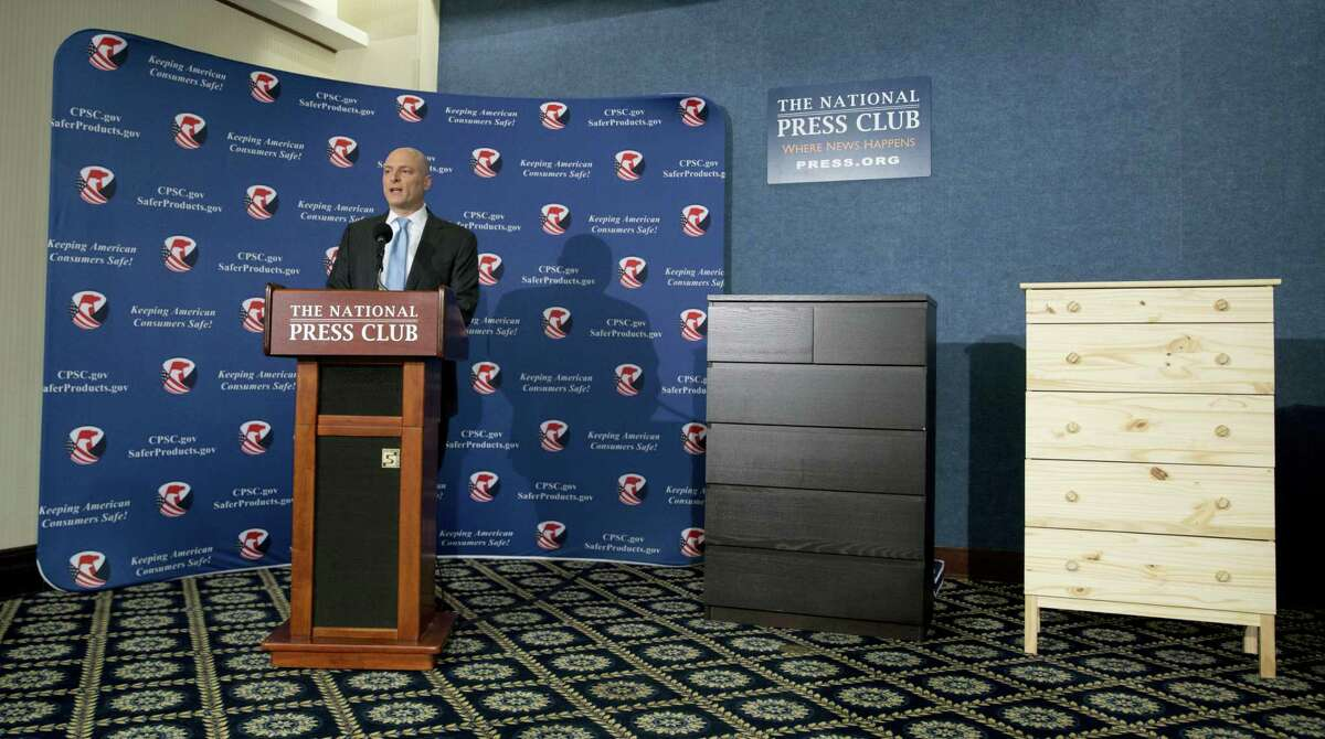 With two Ikea dressers displayed at right, Consumer Product Safety Commission (CPSC) Chairman Elliot Kaye speaks during a news conference at the National Press Club in Washington on June 28, 2016.