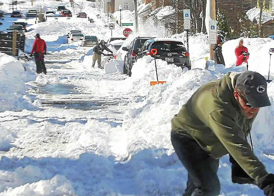 During this time of year, shoveling out a neighbor's driveway without being asked is a simple way to spread kindness. Photo: File Photo