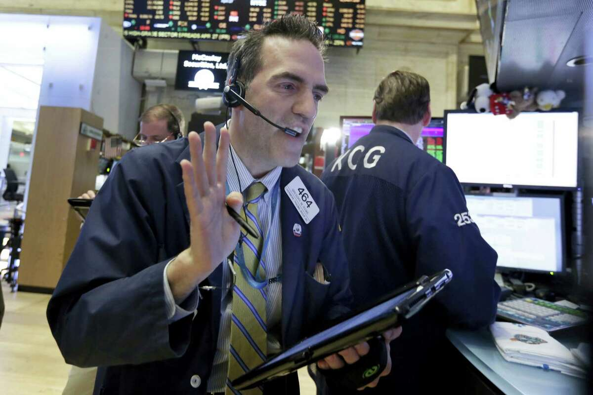 Trader Gregory Rowe works on the floor of the New York Stock Exchange Wednesday.