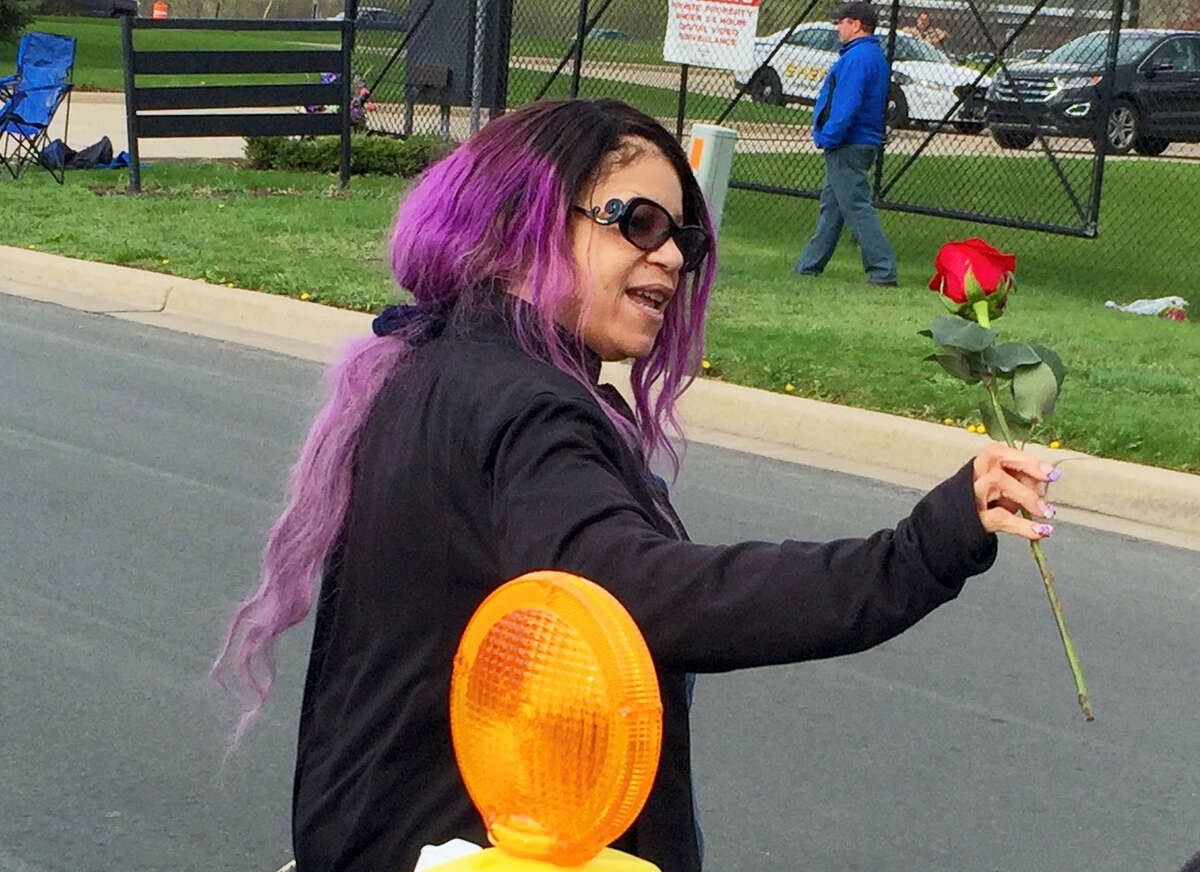 Tyka Nelson holds a rose outside Paisley Park, the home of her brother Prince in Chanhassen, Minn., on Thursday, April 21, 2016. Nelson went out to thank fans who gathered at the home to mourn the loss of the pop star who recently died.