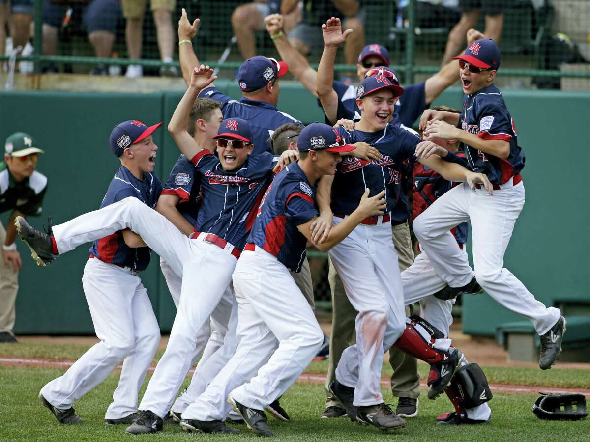 Members of the Endwell, N.Y., team celebrate their win over South Korea in Sunday's championship game at the Little League World Series.