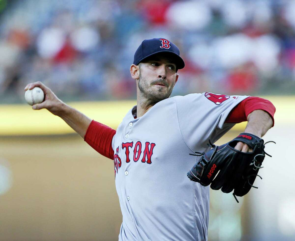 Boston Red Sox starting pitcher Rick Porcello (22) works against the Atlanta Braves in the first inning of a baseball game Monday, April 25, 2016, in Atlanta. (AP Photo/John Bazemore)