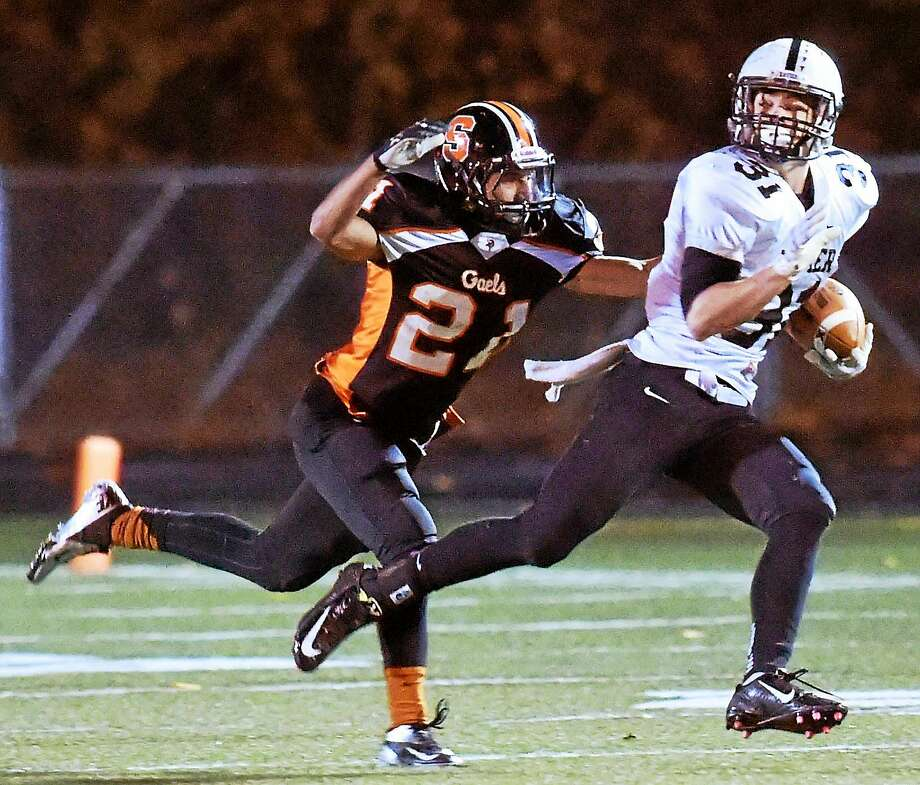 (Photo by Peter Hvizdak - New Haven Register) ¬ Edward Deptula of Shelton High School tries to run down Collin McCarthy of Xavier H.S.  during second quarter football action at Shelton Friday evening, November 7, 2014. Photo: ©2014 Peter Hvizdak / ©2014 Peter Hvizdak