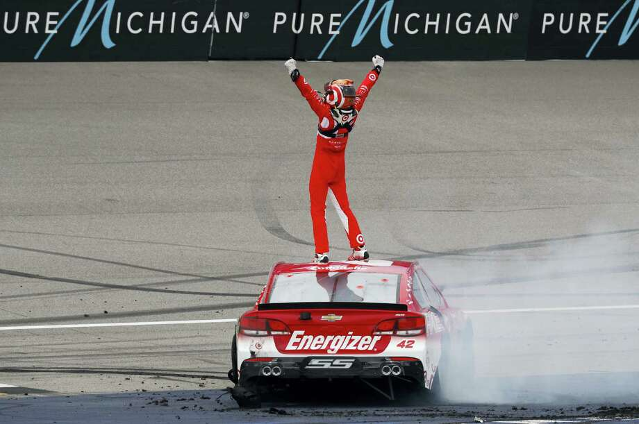 Kyle Larson celebrates winning at Michigan International Speedway on Sunday. Photo: Paul Sancya — The Associated Press  / Copyright 2016 The Associated Press. All rights reserved. This material may not be published, broadcast, rewritten or redistribu