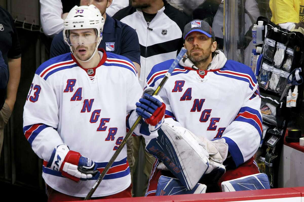 Rangers goalie Henrik Lundqvist (30) and Raphael Diaz (33) watch the final seconds tick off the clock during a playoff loss to the Penguins.