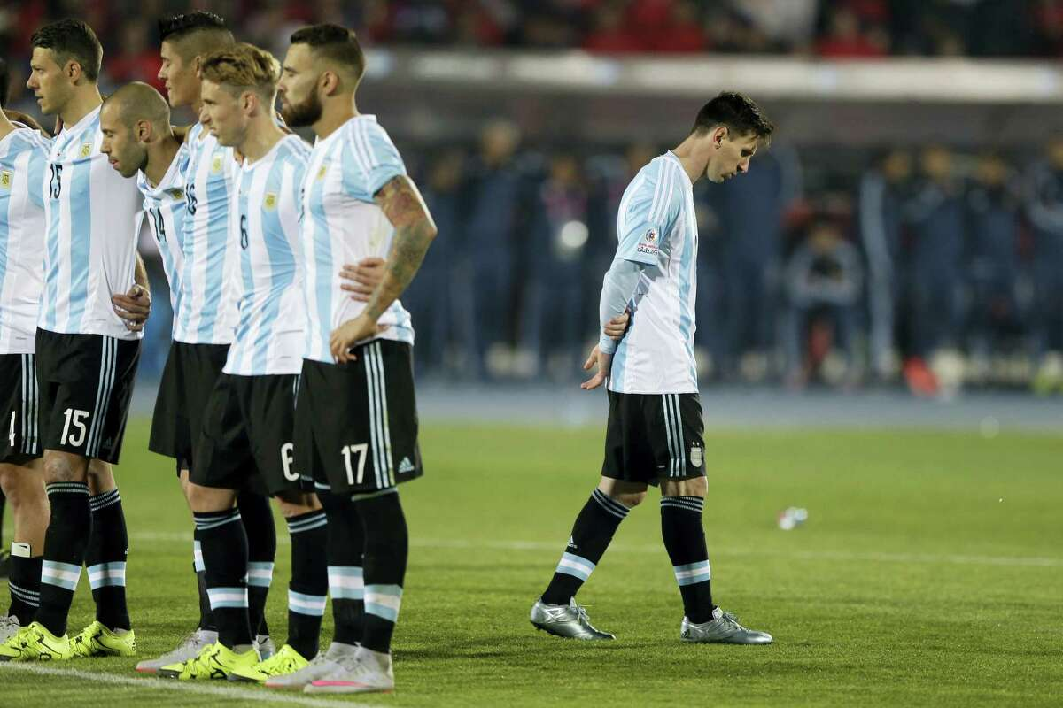 Argentina's Lionel Messi, right, reacts after Argentina's Gonzalo Higuain, missed his penalty kick against Chile during the 2015 Copa America final soccer match in Santiago, Chile.