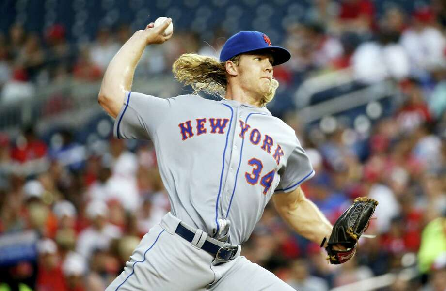 Mets starting pitcher Noah Syndergaard throws during the second inning against the Nationals Monday in Washington. Photo: Alex Brandon — The Associated Press  / Copyright 2016 The Associated Press. All rights reserved. This material may not be published, broadcast, rewritten or redistribu