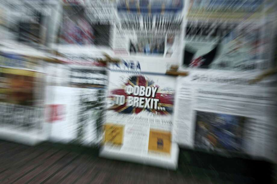 "The front page of Greek daily newspaper Ta Nea reading "" Beware of Brexit"" is on display outside a kiosk in Athens, on Saturday, June 25, 2016. Britain and the EU haven't even begun divorce talks but they are already bickering, as political and economic shockwaves from the British vote spread around the world. Photo: AP Photo/Yorgos Karahalis   / Copyright 2016 The Associated Press. All rights reserved. This material may not be published, broadcast, rewritten or redistribu"
